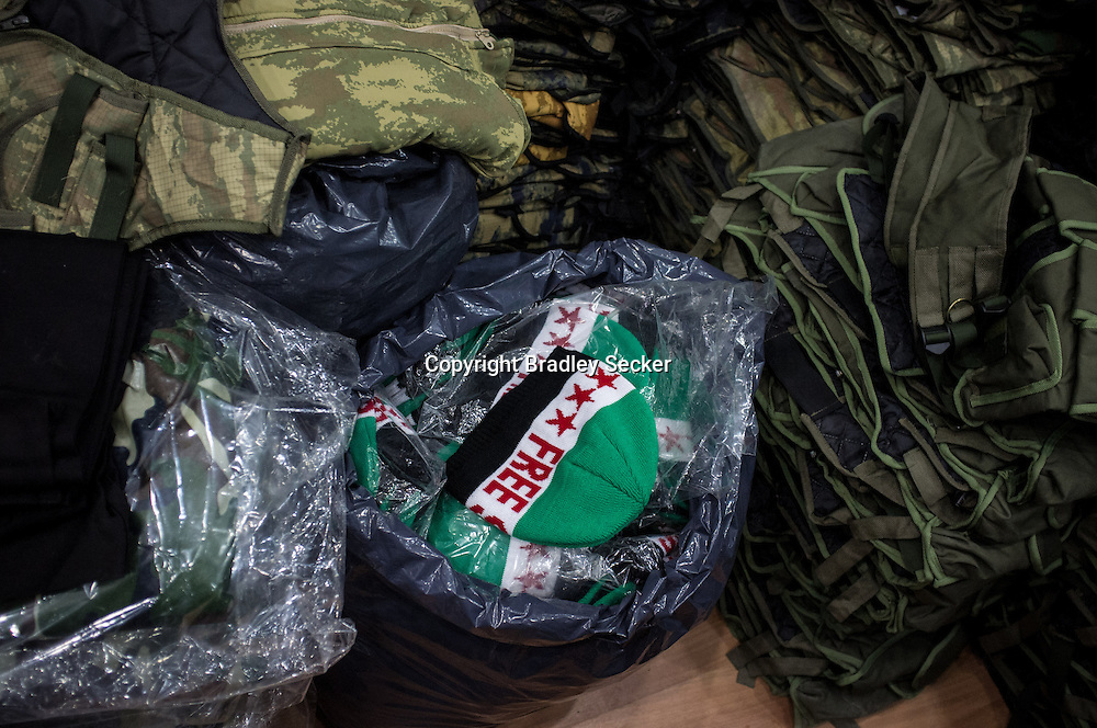 ANTAKYA, TURKEY. JANUARY 23. Winter hats with the pre-Baath party Syrian flag and the words 'Free Syria', on sale from one of Antakya's military stores. Bradley Secker for the Washington Post