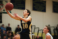 Essex's Riley Smith (10) leaps for a lay up during the boys basketball game between the Essex Hornets and the Colchester Lakers at Colchester High School on Tuesday night December 15, 2015 in Colchester. (BRIAN JENKINS/for the FREE PRESS)