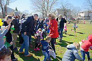North Merrick, New York, USA. March 31, 2018. Nassau County Executive LAURA CURRAN (at center, in red coat) walks through crowd of children and their parents after Curran started the Egg Hunt at the Annual Eggstravaganza, held at Fraser Park. Young children rushed to collect eggs in their Easter baskets.