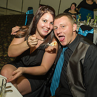 Wedding guests feed one another at the Roma Banquet Hall in Garden City, MI.