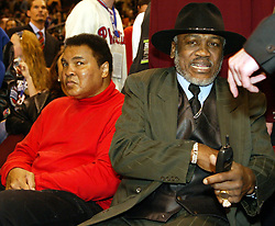 June 3, 2016 - File - MUHAMMAD ALI, the three time heavyweight boxing champion, has died at the age of 74. He had been fighting a respiratory illness. Pictured: Feb. 10, 2002 - Philadelphia, Pennsylvania, U.S. - Joe Frazier was pleasantly surprised to find Muhammad Ali seated next to him during the NBA All-Star game. (Credit Image: © George Reynolds/Philadelphia Daily News/TNS/ZUMAPRESS.com)