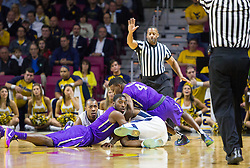 Nov 16, 2015; Charleston, WV, USA; Players dive for a loose ball during the first half at the Charleston Civic Center. Mandatory Credit: Ben Queen-USA TODAY Sports