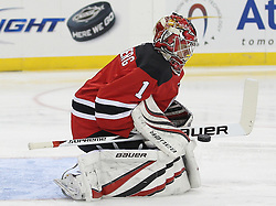 Apr 10; Newark, NJ, USA; New Jersey Devils goalie Johan Hedberg (1) makes a save during the first period of their game against the Boston Bruins at the Prudential Center.
