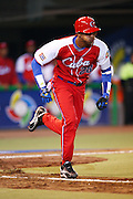 MEXICO CITY - MARCH 10: Second baseman Hector Olivera #28 of Cuba runs to first base during the Pool B, game four against Australia in the first round of the 2009 World Baseball Classic at Foro Sol Stadium in Mexico City, Mexico, Tuesday March 10, 2009. Cuba defeated Australia 5-4. (Photo by Paul Spinelli/WBCI/MLB Photos) *** Local Caption *** Hector Olivera