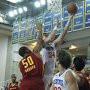 Delaware 87ers Center Kyrylo Fesenko (34) drives towards the basket as Canton Charge Center Arinze Onuaku (50) defends in the first half of a NBA D-league regular season basketball game between the Delaware 87ers (76ers) and The Canton Charge (Cleveland Cavaliers) Friday, Jan 24, 2014 at The Bob Carpenter Sports Convocation Center, Newark, DEL.