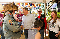 NH State Representative Harry Bean welcomes Governor Chris Sununu at the Naswa Resort on Wednesday evening to celebrate the 96th Motorcycle Week Rally.  (Karen Bobotas/for the Laconia Daily Sun)