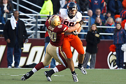 November 20, 2010; Chestnut Hill, MA, USA;  Virginia Cavaliers tight end Colter Phillips (89) is tackled by Boston College Eagles linebacker Luke Kuechly (40) during the fourth quarter at Alumni Stadium.  Boston College defeated Virginia 17-13.