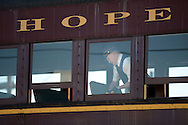 LANSDALE, PA - AUGUST 24: Conductor Wayne Whiteley of Langhorne, Pennsylvania closes windows aboard the New Hope and Ivyland Railroad during Founders Day August 24, 2013 in Lansdale, Pennsylvania. The New Hope and Ivyland Railroad made special trips as part of Founders Day from Lansdale to Souderton. (Photo by William Thomas Cain/Cain Images)