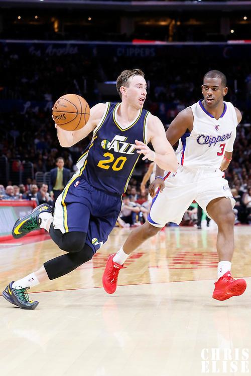 17 October 2014: Utah Jazz guard Gordon Hayward (20) drives past Los Angeles Clippers guard Chris Paul (3) during the Los Angeles Clippers 101-97 victory over the Utah Jazz, in a preseason game, at the Staples Center, Los Angeles, California, USA.