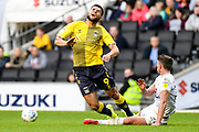 Coventry City striker Max Biamou (9) is fouled by Milton Keynes Dons midfielder Jordan Houghton (24) during the EFL Sky Bet League 1 match between Milton Keynes Dons and Coventry City at stadium:mk, Milton Keynes, England on 19 October 2019.