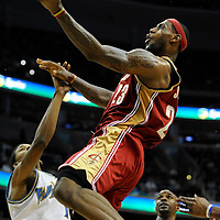 04 January 2009:   Cleveland Cavaliers forward LeBron James (23) scores 2 of his game high 30 points in the 2nd half against Washington Wizards guard Nick Young (1) at the Verizon Center in Washington, D.C.  The Wizards defeated the Cavaliers 80-77.