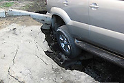 The Russian city being 'eaten alive': Cars, buses, and trucks disappear beneath the earth as they are swallowed by giant sinkholes<br /> <br /> They may look like stills from an apocalyptic horror film, but these images have become a daily reality for residents in a Russian city. <br /> Citizens of Samara, in south east Russia, live in fear of the ground literally disappearing beneath them after huge sinkholes have started to appear all over their city, leaving devastation in their wake. <br /> The yawning underground caverns are all believed to have sprung up in recent weeks swallowing cars, buses and claiming at least one life.<br /> The sinkholes, some large enough to swallow an entire truck, are believed to have been caused by ground subsidence. <br /> It is thought the holes have been caused as ice thaws and melts into the ground, with the excess water causing soil decay underneath Samara's roads. <br /> The massive craters have appeared in car parks, busy intersections, by the sides of roads, and on major and minor thoroughfares.<br /> <br /> It is believed at least one person has lost their life as a result of one of the crashes caused by the sinkholes.<br /> The citizens of the city have now signed a petition urging authorities to find a solution. <br /> Sinkholes are common hazards in mining regions, plaguing areas where miners have burrowed into layers of soluble minerals and accidental floods have followed.<br /> But natural sinkholes can take thousands of years to form and vary in size.<br /> They are usually the result of what are known as Karst processes, which occur when a layer of rock such as limestone underneath the ground is dissolved by acidic water.<br /> Typically rainfall seeps through the soil, absorbing carbon dioxide and reacting with decaying vegetation. As a result, the water that reaches the soluble rock is acidic.<br /> <br /> <br /> The acidic water then erodes the soluble rock layers beneath the surface creating cavernous spaces.<br /