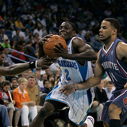 Apr 07, 2010; New Orleans, LA, USA; New Orleans Hornets guard Darren Collison (2) drives between Charlotte Bobcats guard Stephen Jackson (1) and guard D.J. Augustin (14) during the second half at the New Orleans Arena. The Bobcats defeated the Hornets 104-103. Mandatory Credit: Derick E. Hingle-US PRESSWIRE