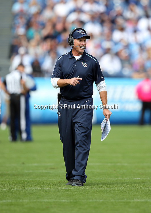Tennessee Titans head coach Ken Whisenhunt points during the NFL week 6 regular season football game against the Jacksonville Jaguars on Sunday, Oct. 12, 2014 in Nashville, Tenn. The Titans won the game 16-14. ©Paul Anthony Spinelli