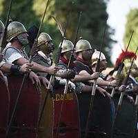 Aquileia, Italy - 17 June 2018: Ancient Roman Legionaries look on during Tempora in Aquileia, ancient Roman historical re-enactment