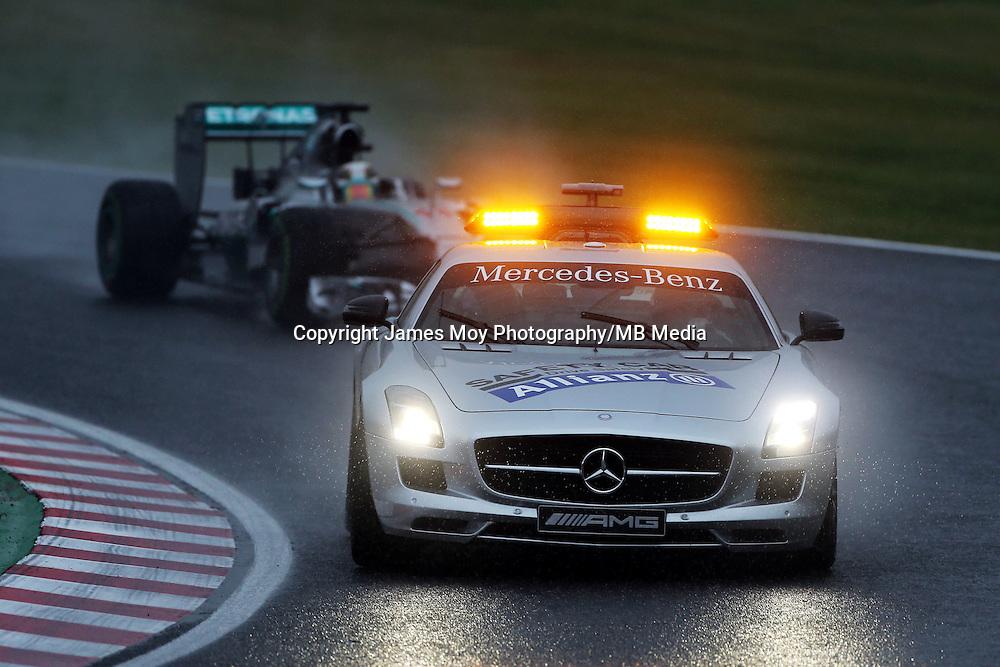 Race winner Lewis Hamilton (GBR) Mercedes AMG F1 W05 leads behind the FIA Safety Car.<br /> Japanese Grand Prix, Sunday 5th October 2014. Suzuka, Japan.