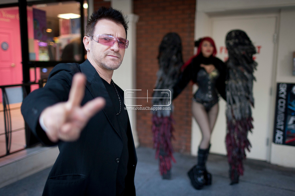 February 20th, 2012, Las Vegas, Nevada. The 21st Annual Reel Awards in Las Vegas where celebrity lookalikes show off their talents. Pictured is Pavel Sfera as Bono with Las Vegas street performer, Dark Angel.. PHOTO © JOHN CHAPPLE / www.johnchapple.com.