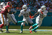 Sunday, October 13, 2019; Miami Gardens, FL USA;  Miami Dolphins middle linebacker Raekwon McMillan (52) and free safety Reshad Jones (20) prepare to pressure the running game during an NFL game against Washington at Hard Rock Stadium. The Redskins beat the Dolphins 17-16. (Kim Hukari/Image of Sport)