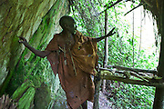 James, one of the elders of the traditional Batwa pygmies from the Bwindi Impenetrable Forest in Uganda demonstrates where they used to live. They were indigenous forest nomads before they were evicted from the Bwindi Impenetrable Forest when it was made a World Heritage site to protect the mountain gorillas.  The Batwa Development Program now supports them.