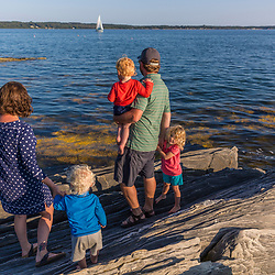 A young family on East Gosling Island in Casco Bay, Harpswell, Maine.