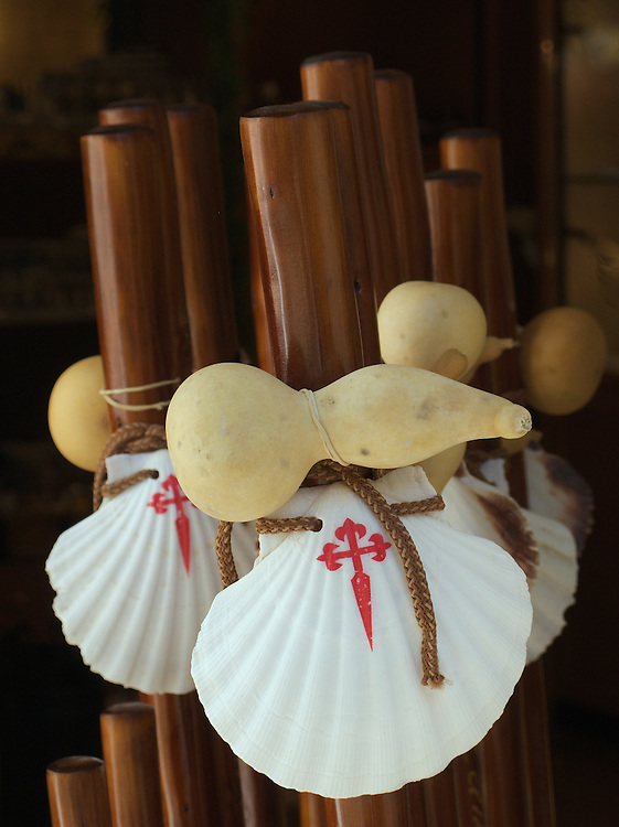 In Santiago de Compostela there were many souvenirs for sale. These traditional pilgrim staffs had a gourd and scallop shell attached. It is traditional to use such a walking stick along the Camino de Santiago.