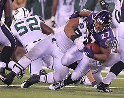 Sept 13, 2011; East Rutherford, NJ, USA; Baltimore Ravens running back Ray Rice (27) is tackled by New York Jets defensive tackle Sione Pouha (91) during the second half at the New Meadowlands Stadium.  The Ravens defeated the Jets 10-9.