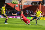 Alex Baptiste suffers following a challenge and suffers horrific injury during the Friendly match between York City and Middlesbrough at Bootham Crescent, York, England on 11 July 2015. Photo by Simon Davies.