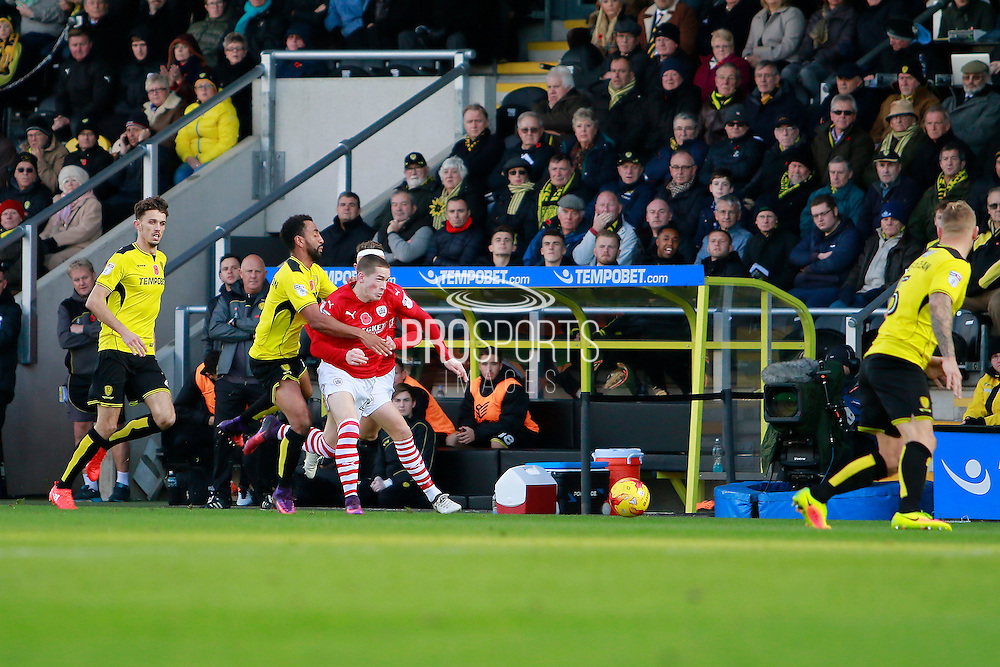 Burton's Lee Williamson (7) fouls Barnsley's Ryan Kent (40) during the EFL Sky Bet Championship match between Burton Albion and Barnsley at the Pirelli Stadium, Burton upon Trent, England on 5 November 2016. Photo by Richard Holmes.