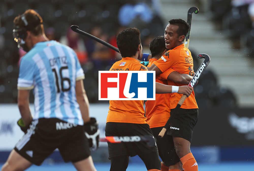 LONDON, ENGLAND - JUNE 16:  Malaysia players celebrate their second goal scored by Tengku Tajuddin during the Pool A match between Argentina and Malaysia on day two of Hero Hockey at Lee Valley Hockey and Tennis Centre on June 16, 2017 in London, England.  (Photo by Alex Morton/Getty Images)