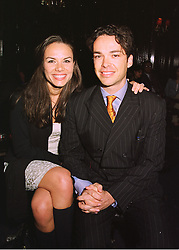 MISS LILI MALTESE and her fiance MR HENRY DENT-BROCKLEHURST, at a fashion show on 15th April 1998.MGP 18