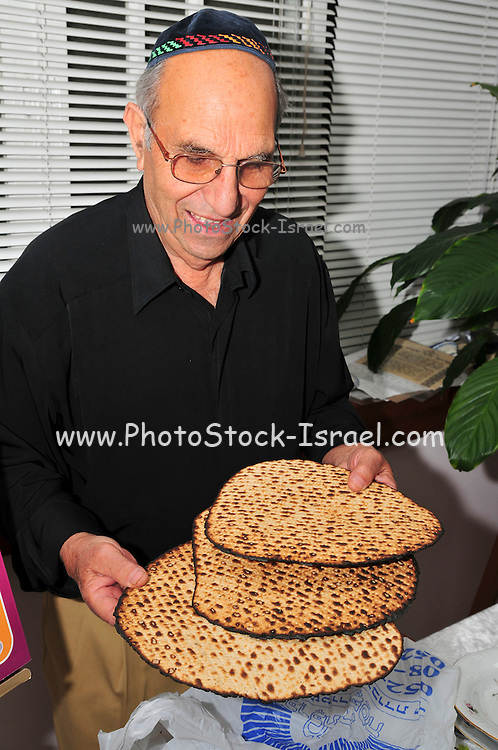 Family around the table for the traditional passover dinner, Handmade Matzah Shmura