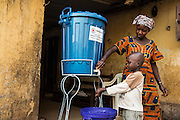 One of the most important of these areas is contact tracing, or finding persons who have been in close contact with persons infected with Ebola, monitoring them to see if they have become infected, and providing them with education and support. The family has been provided with buckets and chlorine and taught how to wash hands properly at home. Photo UNMEER /Martine Perret. 14 January 2015