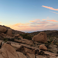 Sunset illuminates the skies of Joshua Tree National Park, CA, with beautiful colors, high above the Split Rock area of the park. Joshua Tree NP, 29 Palms, CA.