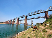 India, Madhya Pradesh. Gher, Chambal Railway Bridge. Maharajas' Express luxury train crossing from Rajasthan.