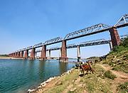 India, Madhya Pradesh. Gher, Chambal Railway Bridge. Maharajas' Express luxury train crossing from Rajasthan.