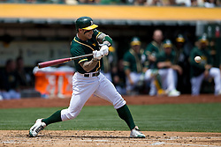 OAKLAND, CA - JULY 23:  Brett Lawrie #15 of the Oakland Athletics at bat against the Toronto Blue Jays during the second inning at O.co Coliseum on July 23, 2015 in Oakland, California. The Toronto Blue Jays defeated the Oakland Athletics 5-2. (Photo by Jason O. Watson/Getty Images) *** Local Caption *** Brett Lawrie