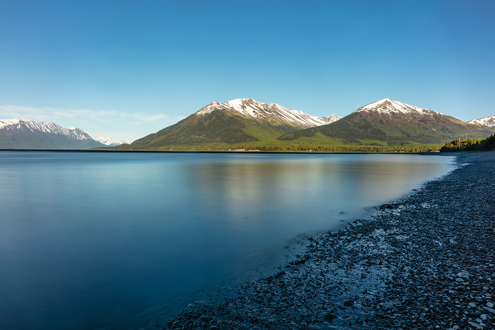 Long exposure of rising tide of Turnagain Arm near Hope in Southcentral Alaska. Spring. Evening.