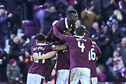 Top of the heap: Isma Goncalves jumps aboard Hearts' winning goal celebration in the William Hill Scottish Cup 4th round match between Heart of Midlothian and Hibernian at Tynecastle Stadium, Gorgie, Scotland on 21 January 2018. Photo by Kevin Murray.