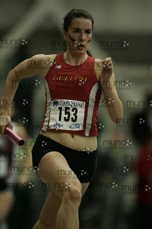 (Windsor, Ontario---13 March 2010) Nadine Frost of University of Guelph Gryphons  competes in the women's 4x400 meters at the 2010 Canadian Interuniversity Sport Track and Field Championships at the St. Denis Center. Photograph copyright GEOFF ROBINS/Mundo Sport Images. www.mundosportimages.com
