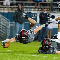 ARVADA - SEPT. 22: Pomona's Max Borghi dives over teammate Colton Muller under pressure from Valor Christian's Ethan Zemla during the first half of a Class 5A nonconference high school varsity football game held at the North Area Athletic Complex. (Photo by Andy Colwell/ Special to The Denver Post)