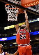 Nov. 14, 2012; Phoenix, AZ, USA; Chicago Bulls forward Taj Gibson (22) dunks the ball during the game against the Phoenix Suns in the first half at US Airways Center. Mandatory Credit: Jennifer Stewart-US PRESSWIRE.