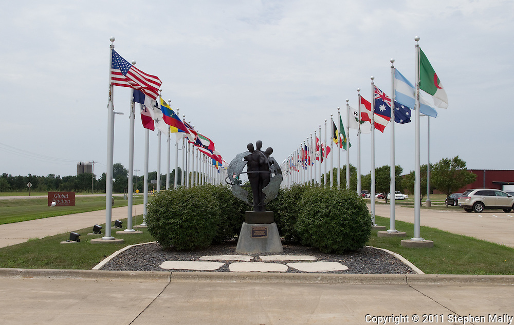 The international presence of Vermeer is illustrated by flags outside the Vermeer Global Pavilion in Pella, Iowa on Thursday, July 28, 2011.