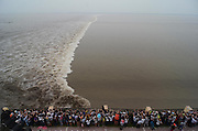 HAINING, CHINA - SEPTEMBER 08: (CHINA OUT) <br /> <br /> Celebrating The Mid-Autumn Festival In China<br /> <br /> People gather to watch the one-line bore at the bank of Qiantang river on September 8, 2014 in Haining, Zhejiang Province of China. The one-line bore has attracted about 95 thousand tourists to watch during China's Mid-Autum Festival.<br /> ©Exclusivepix
