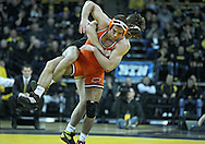 January 07, 2011: Iowa's Mike Evans tries to score a takedown on Oklahoma State's Dallas Bailey during the 165-pound bout in the NCAA wrestling dual between the Oklahoma State Cowboys and the Iowa Hawkeyes at Carver-Hawkeye Arena in Iowa City, Iowa on Saturday, January 7, 2012. Evans won 5-1.