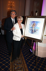 GLORIA HUNNIFORD and her husband STEPHEN WAY at a reception to launch Angel themed Christmas Cards and view an exhibition of the original art work by Gordon King with proceeds going to the Caron Keating Foundation  held at the Langham Hotel, Portland Place, London on 20th November 2006.<br />