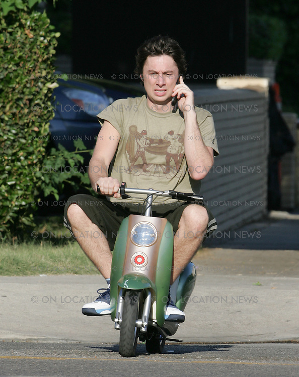 August 22nd 2006 ***EXCLUSIVE*** Zach Braff rides a mini scooter to the set of Scrubs while chatting on a cell phone. Photo by Eric Ford 818-613-3955 info@onlocationnews.com