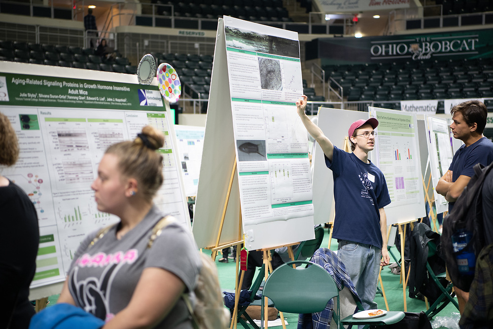 Michael Weinstein presents his poster at the Student Expo  at the Convocoation Center Friday April 13. Photo by Ben Siegel