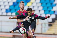 Portugal, FUNCHAL : Benfica's Argentine midfielder Salvio  (R)  vies with Maritimo's German defender Patrick Bauer   (R ) during Portuguese League football match Maritimo vs S.L. Benfica at Barreiros Stadium in Funchal on January  18, 2015. AFP PHOTO/ GREGORIO CUNHA