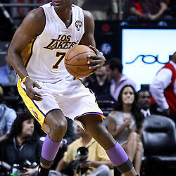 March 10, 2011; Miami, FL, USA; Los Angeles Lakers power forward Lamar Odom (7) against the Miami Heat during the first quarter at the American Airlines Arena.  Mandatory Credit: Derick E. Hingle