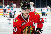 KELOWNA, BC - MARCH 03: Joachim Blichfeld #20 of the Portland Winterhawks stands at the bench during warm up against the Kelowna Rockets at Prospera Place on March 3, 2019 in Kelowna, Canada. (Photo by Marissa Baecker/Getty Images)